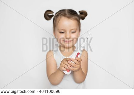 Cute Little Baby Girl With Her Hair In Ponytails, Standing On Isolated White Background, Excited To