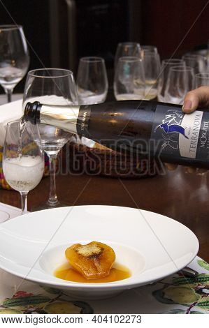 Dessert Of Pear Brulee With Dolce Gorgonzola Cheese. Harmonized With Sparkling Moscatel.