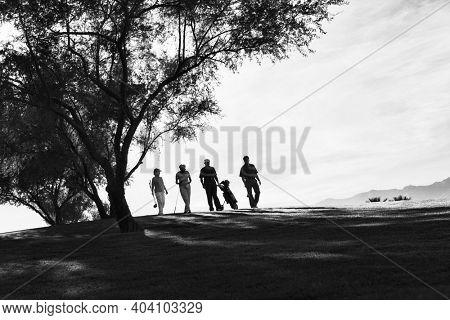 Black and white photo of senior golfer friends