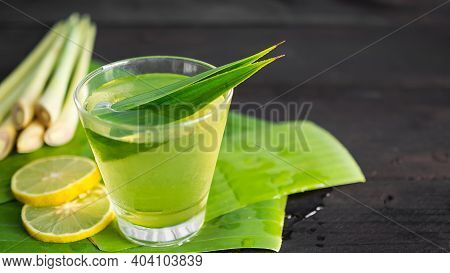 Lemongrass Juice In Glass On Wooden Background. Thai Herbal Drink. For Cough Remedy, Reduce Headache