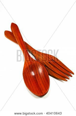 Wooden Kitchen Spoons, Forks On A White Background