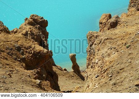 The View Of The Rock Formations And Blue Water At Krafla Viti Crater Near Lake Myvatn, Iceland In Th