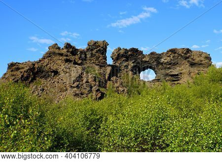 The View Of The Unique Rock Structure And The Cave At Dimmuborgir Lava Formations Near Lake Myvatn,