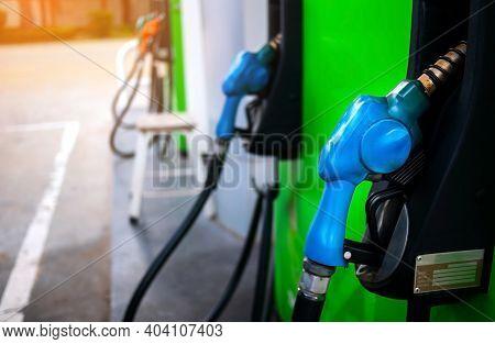 Fuel Oil Gasoline Dispenser At Petrol Filling Station.holding Fuel Nozzle To Refuel Gasoline For Car