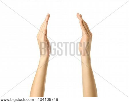 Holding Or Measuring Hands. Woman Hand With French Manicure Gesturing Isolated On White Background.