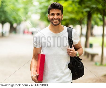 Smiling student outdoor in a college courtyard