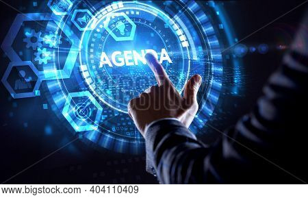 Business, Technology, Internet And Network Concept. Businessman With Agenda Word.