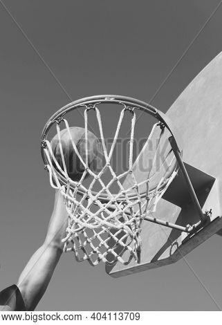 Black and white photo of Player Dunking the Ball