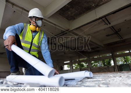 Black People Construction Worker Wearing Face Mask And Safety Helmet While Looking To An Area Follow