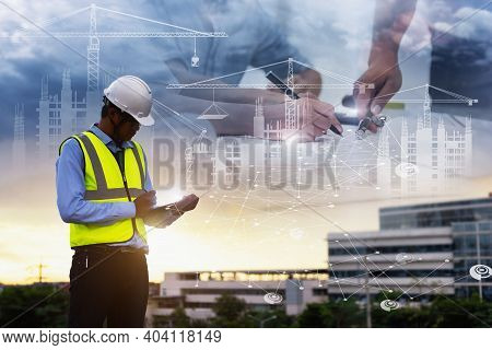 Engineering Consulting People On Construction Site Holding Tablet In His Hand. Management In Busines