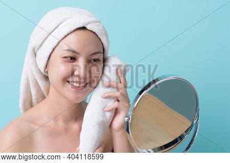 Beautiful Asian Young Woman Smiling And Touching Face With Towel While Looking At Mirror With Copy S
