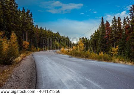 The Rocky Mountains of Canada. Indian summer in Jasper Park. Magnificent mountain highway among coniferous forests. Travel and photo tourism concept