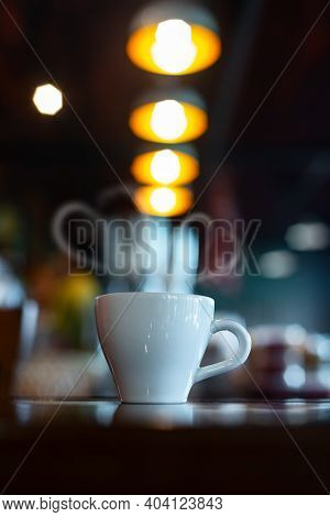 Hot Coffee Cup On Wood Table In Blurred Coffee Shop Background.