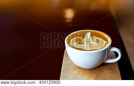 Panorama Cup Of Hot Latte Art Coffee On Wooden Table