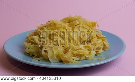 Stewed White Cabbage On A Plate. A Dish Of Russian Cuisine. Garnish In The Ussr.