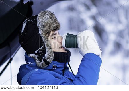 Profile Side Photo Of Handsome Guy In Winter Warm Clothes In Snow Drinking Hot Drink Tea Or Coffee F