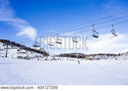 Auron, France - 30.12.2020: Empty Ski Slopes And Ski Lifts In Ski Resort. During The Winter Holidays