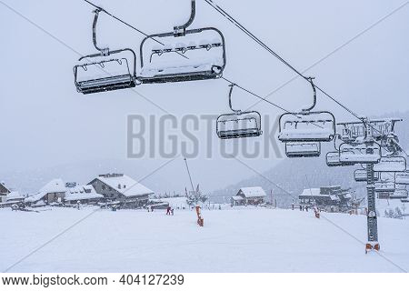 Auron, France - 01.01.2021: Empty Ski Slopes And Ski Lifts In Ski Resort. During The Winter Holidays