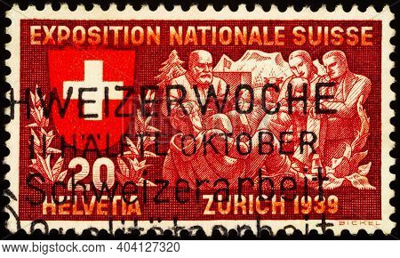 Moscow, Russia - January 17, 2021: Stamp Printed In Switzerland Shows Visitors Listen To A Poet, Ser