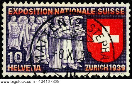 Moscow, Russia - January 17, 2021: Stamp Printed In Switzerland Shows Swiss Bring Their Handicrafts