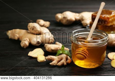 Honey And Ginger On Black Wooden Table. Natural Cold Remedies