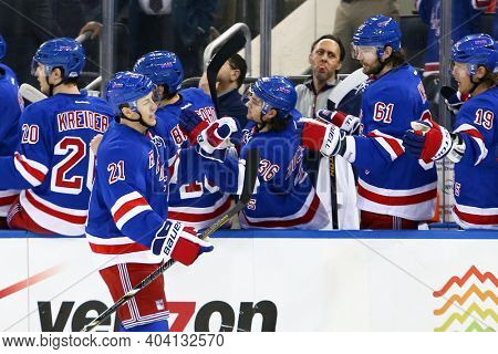 NEW YORK-APR 27: New York Rangers center Derek Stepan (21) celebrates with teammates after scoring a goal at Madison Square Garden on April 27, 2013 in New York City.