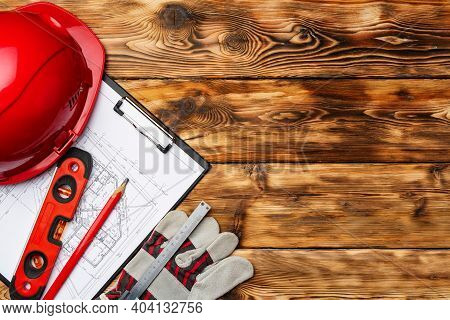 Construction Worker Hardhat, Blueprints And .construction Level, Top View