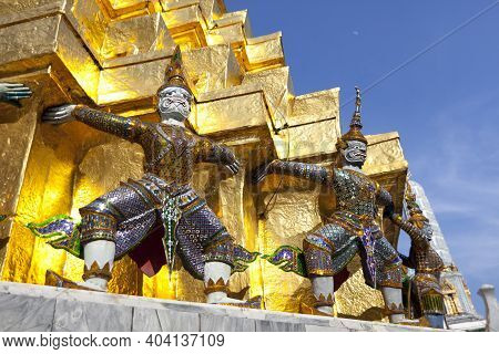 Demon Guardian Statue Against A Blue Sky In Wat Phra Kaew (temple Of The Emerald Buddha), Grand Pala