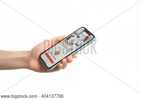 Mykolaiv, Ukraine - July 9, 2020: Woman Holding  Iphone X With Pinterest App On White Background, Cl