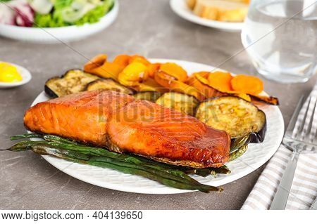 Delicious Cooked Salmon And Vegetables On Grey Table, Closeup. Healthy Meals From Air Fryer