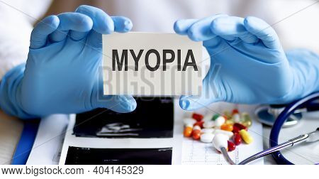 Card With Text Myopia Supplies, Pills And Stethoscope. Medicine