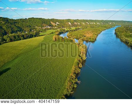 Scenic Aerial View Of The Seine River And Green Fields In French Countryside. Val D'oise Department,