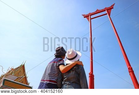 Couple Looking Up To The Amazing Giant Swing Or Sao Ching Cha, Historic Teak Wood Swing Formerly Use