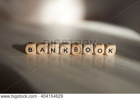 Bankbook Word Is Made With Wooden Cubes