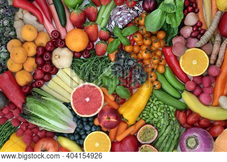 Large plant based collection of fruit and vegetables packed with antioxidants that neutralise free radicals. High fibre diet full of anthocyanins, lycopene, protein, vitamins  minerals.Top view.