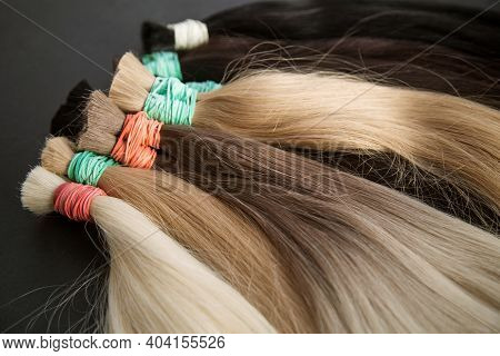 Strands Of Natural Womens Hair For Encapsulation And Extension In A Beauty Salon. . High Quality Pho