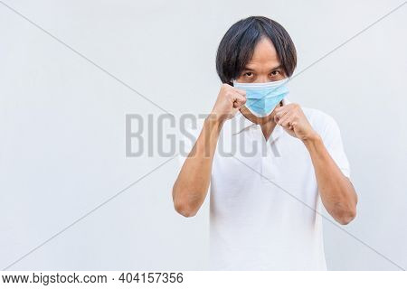 Asian Man Wear Hygienic Mask  And Post Boxing Guard Action For Fight The Disease