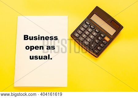 Business Open As Usual - Business Text On Refreshing Background With Calculator