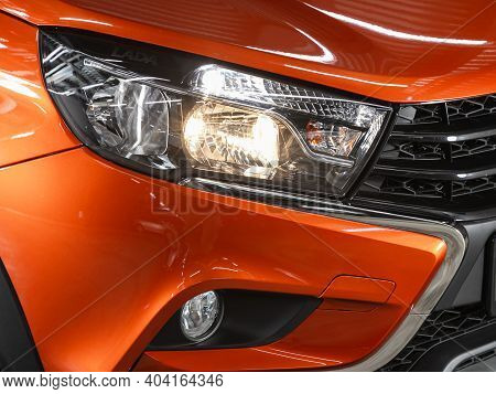 Novosibirsk/ Russia - January 14 2021: Lada Vesta Cross, View Of The Front  Of The Car. Orange  Car