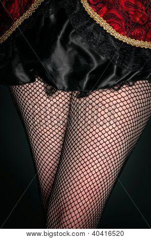 Legs Of A Youn Woman Against Dark Background