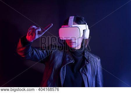 Woman playing a virtual video game on virtual screen
