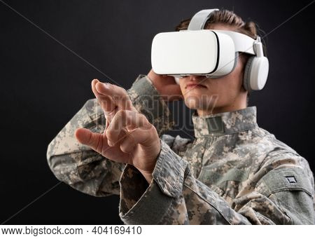 Soldier in VR headset touching virtual screen for simulation training military technology