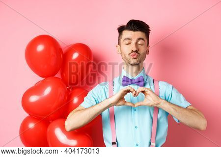 Valentines Day Concept. Passionate Guy Showing Kissing Face And Heart Gesture, Waiting For Love On R