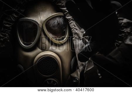 Man in protective suit against dark background poster