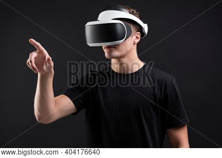 Man wearing VR headsets working on invisible screen futuristic technology