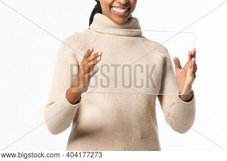 African American woman using transparent digital tablet