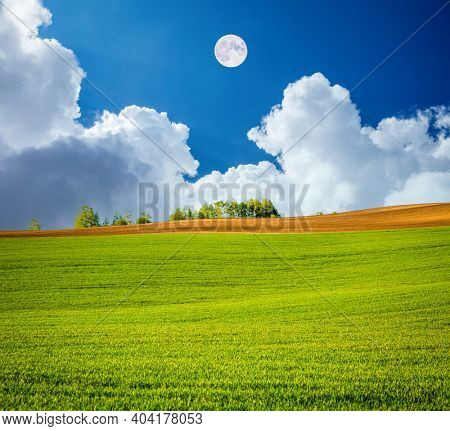 Morning sunlight on the wavy fields and cultivated land of agricultural area. Location place South Moravia region, Czech Republic, Europe. Concept of agrarian industry. Discover the beauty of world.
