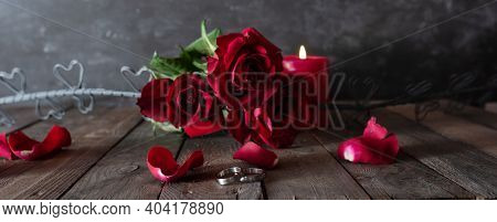 Romantic Love Decoration With Wedding Rings Red Roses And Candlelight In Vintage Style. Horizontal B