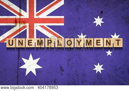 Unemployment. The Inscription On Wooden Blocks On The Background Of The Australian Flag. Unemploymen