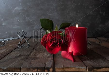 Romantic Love Decoration With Red Roses, Candlelight And Hearts On Vintage Background. Love Concept